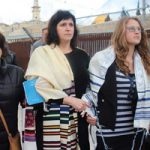 Rabbi Susan Silverman and her daughter Hallel (center) were arrested at the Western Wall after they refused to remove their prayer shawls.