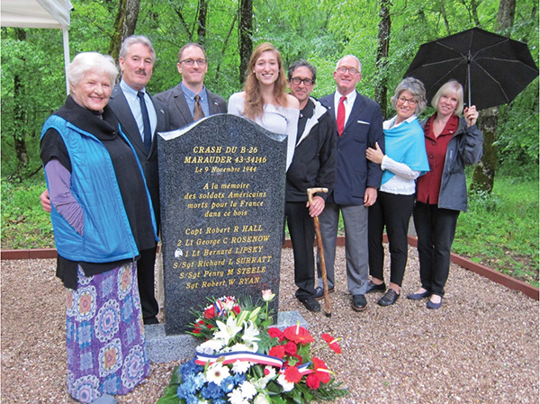 Eve Roberts (left) and her extended family traveled to France for the dedication of a monument to honor her brother, Bernard Lipsky, and his crewmates who died in a plane crash over 70 years ago.