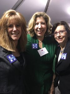 From left to right are Jill Goldenberg, Nanette Fridman, and Miriam May wearing Jewish Women for Hillary pins at a recent event for Hillary.