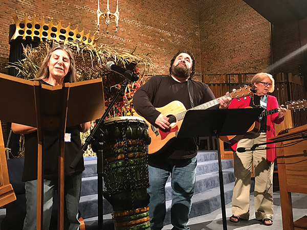 "Amy Saltz, left, John Nelson, center, and Cheryl Boots, right, rehearsed for the ""Sing-In"" at Temple Emanu-El."
