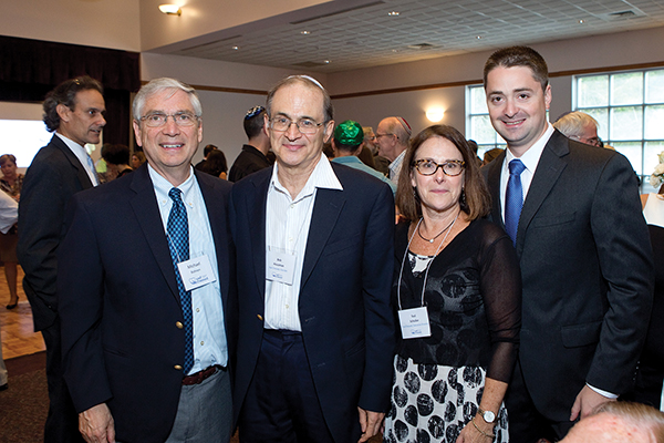 At a Yad Chessed community event from left to right are Michael Bohnen, Host Committee member, Robert Housman, Founder, Suzi Schuller, Executive Director, and Boston City Councilor Josh Zakim.