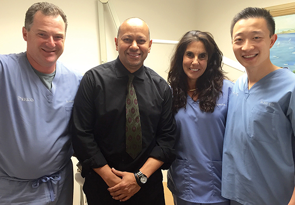 From left to right are Dr. Simon Bernstein, Angel Echavarría, Dr. Fern Selesnick, and Dr. Jeff Li. All three doctors collaborated in fixing Echavarría's teeth at no cost.