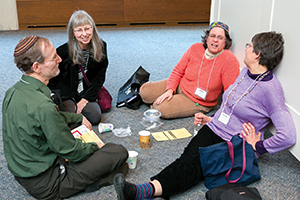 "Conference participants enjoyed a friendly lunch on the floor at the most recent Limmud Boston conference. ""That's very Limmud-like – you know, finding a space and making it yours,"" according to event organizer Steffi Karp."