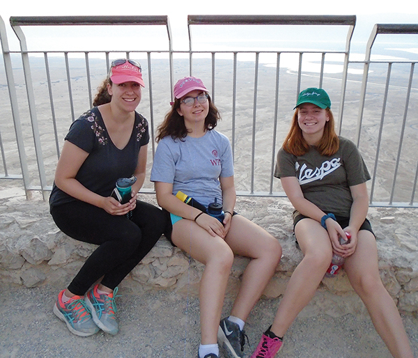 The author, center, recently returned from Israel.