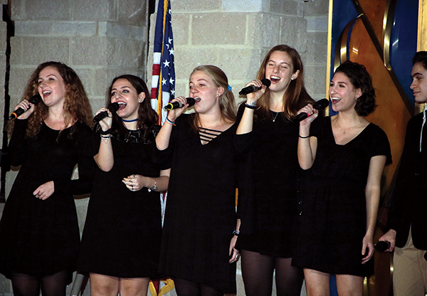 Members of Shir Appeal from Tufts University perform at the New England Jewish Collegiate A Cappella Competition and Showcase.