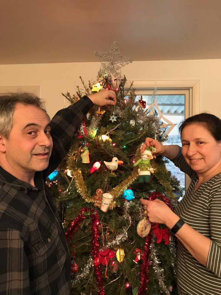 Reed and Larissa Brockman decorate their Yolka tree for Novy God.
