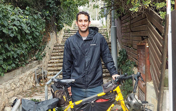 Josh Buchsbaum, with his bike, in Jerusalem.