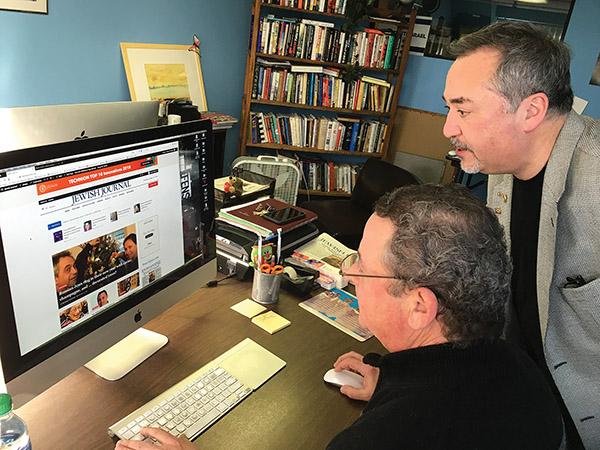 David Deutsch (right) works with production artist Andrew Fleischer on the Journal's new website. Photo by Michael Wittner/Journal Staff