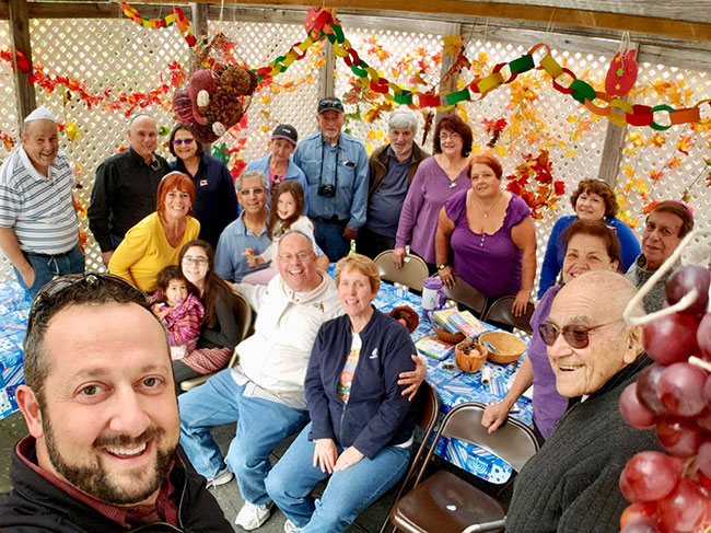 Sons of Israel congregants at a Sukkah-decorating party