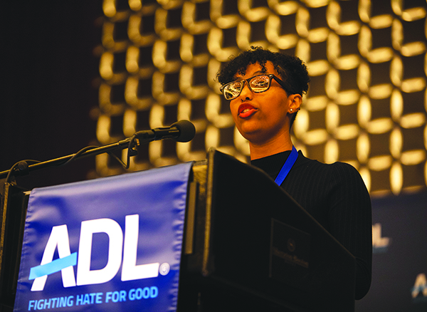 """""""Engage, mobilize and lead,"""" urged Birukte Tsige, a Malden High senior who spoke before more than 1,400 other peer leaders from across the state at N.E. ADL's 25th annual Youth Congress. Photo:  Jake Belcher/courtesy New England ADL"""