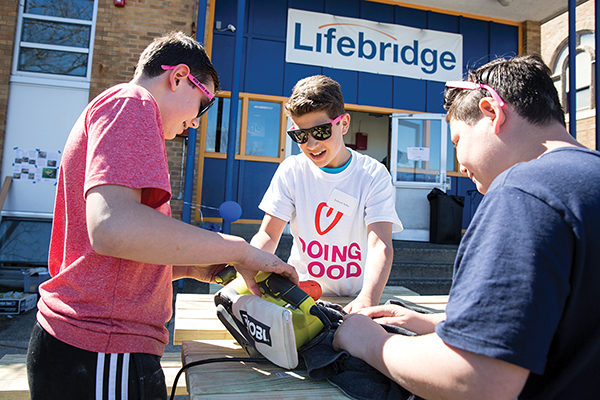 Jackson Selby and friends build picnic benches for Lifebridge as part of the more than 80 teens who volunteered at last year's event.