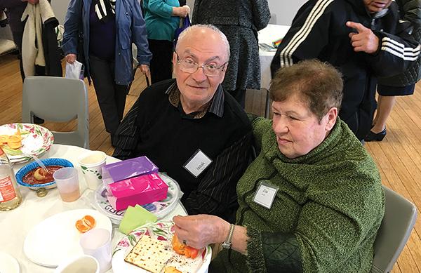 Isaak and Zina Bronfin of Swampscott enjoy Café Hakalah's Seder.