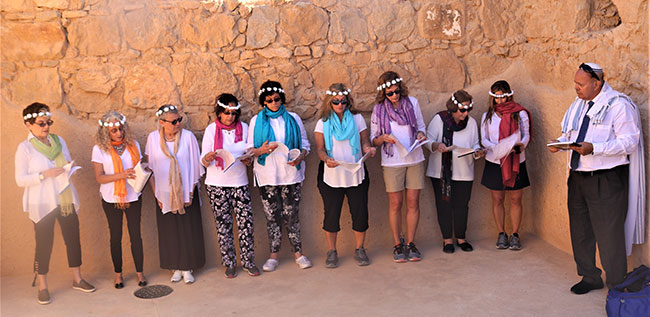 Newly minted b'not mitzvah celebrate at the top of Masada alongside Rabbi Moshe Elbaz.