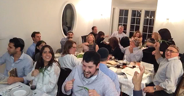 "Dina Davidyan's seder guests tap each other with scallions during ""Dayenu,"" a Sephardic tradition."