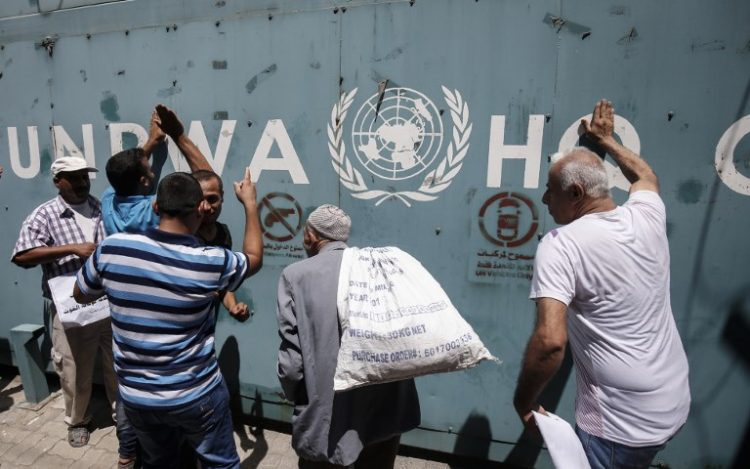 Employees of the UN Relief and Works Agency for Palestine Refugees in the Near East (UNRWA) and their families protest against cuts to their funding by the U.S. in 2018.