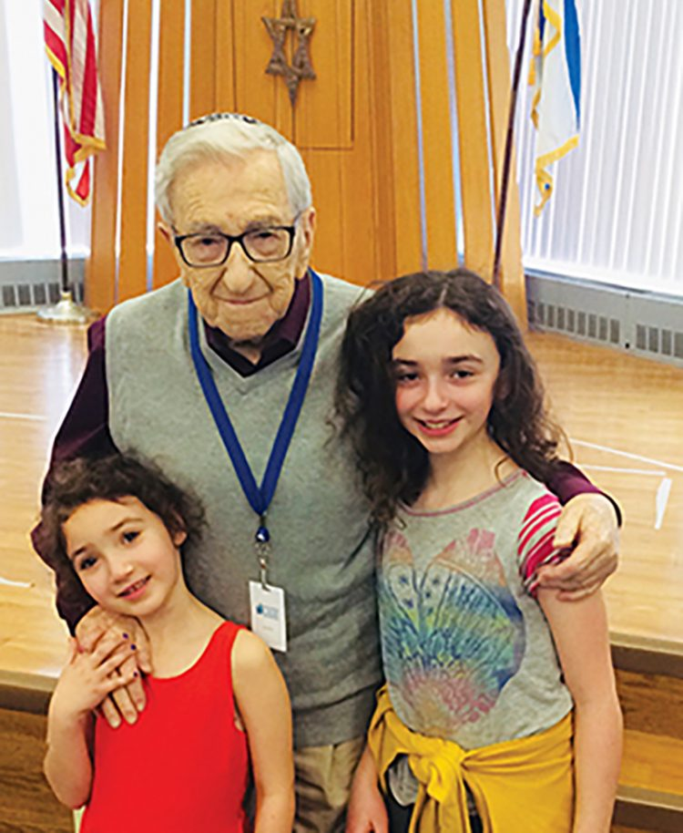 Holocaust survivor Izzy Juda with his great-granddaughters, Meirav and Sasha Ganezer, at Hillel.