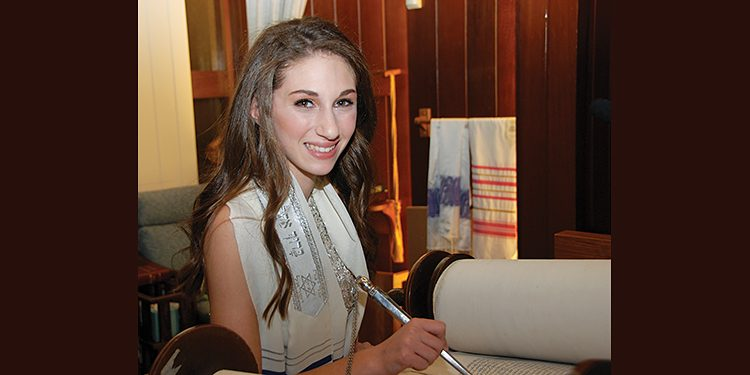 Laci Robbins studying Torah for her bat mitzvah. All photos by Tara Morris Images.