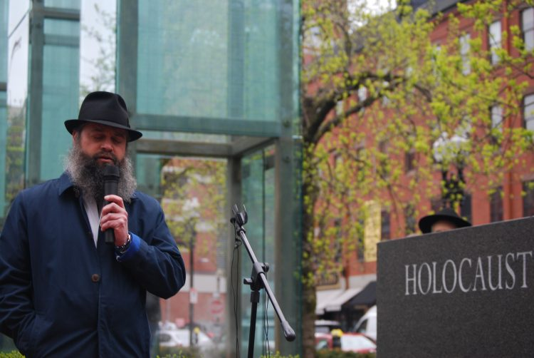 Rabbi Yossi Lipsker recites a prayer for the Poway victims at the vigil. / Photo by Steven A. Rosenberg/Journal Staff