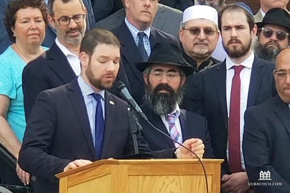 Rabbis Schusterman, Baron and Lipsker of Chabad of the North Shore (far right) together with Peabody Mayor Edward Bettencourt Jr. Photo: ArcWorks