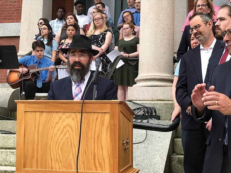 Rabbi Nechemia Schusterman addressed the gathering at Peabody City Hall on June 5. Photos: Steven A. Rosenberg/Journal Staff