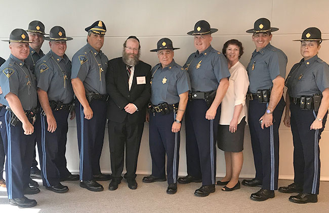 Rabbi Asher Bronstein of the Chabad Lubavitch Jewish Center of the Merrimack Valley has struck up meaningful friendships with local police chiefs and state troopers.