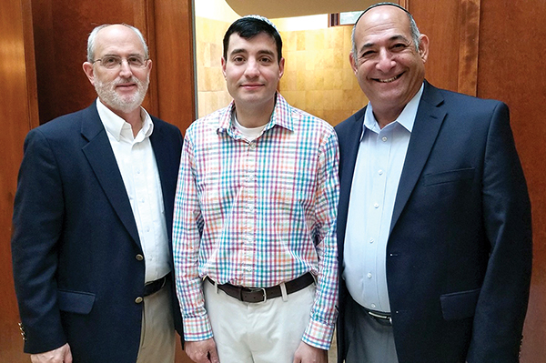Christopher Harrah, center, with Rabbis Richard Perlman, left, and Bernie Horowitz, right, of Temple Ner Tamid in Peabody, who assisted in his recent conversion.