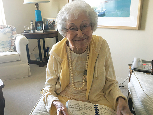 """Estelle Cohen with her Jewish cookbook, """"Shalom in the Kitchen."""" Photo: Michael Wittner"""