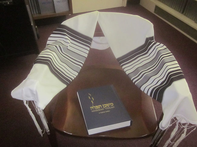 Arnie Sager's armchair, tallit and siddur at Tiferet Shalom in Peabody.