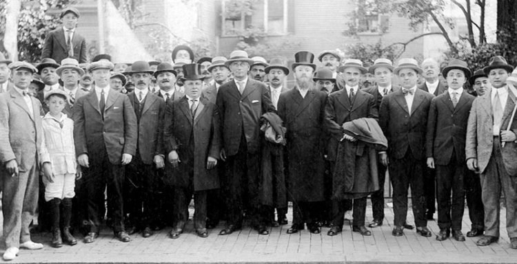 Salem merchant H. Simon, in the front row with a top hat standing next to Justice Louis D. Brandeis, along with other Jewish businessmen in an undated photograph taken near Salem Common.