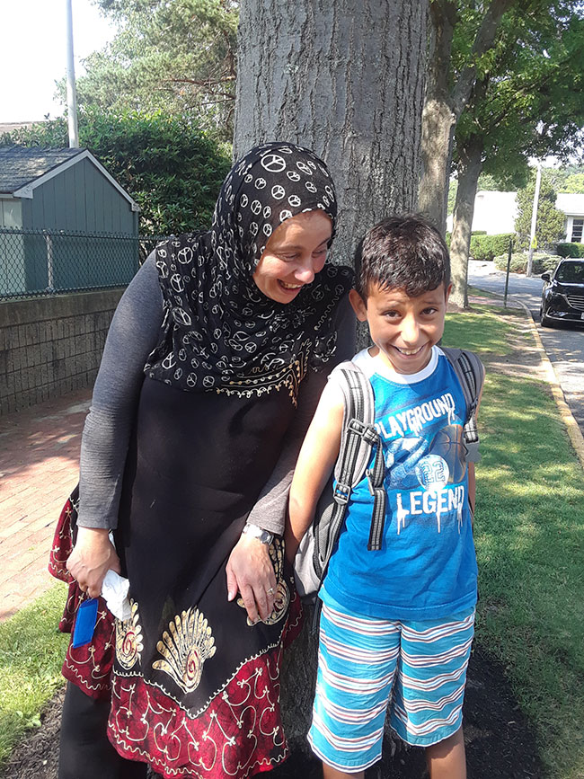 Salima Slimane of Malden drops off her son, Anis, at the JCC of the North Shore in Marblehead.