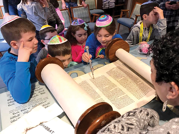 Students at Temple B'nai Abraham in Beverly.