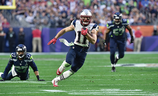 Wide receiver Julian Edelman carries the ball against the Seattle Seahawks. Courtesy of the New England Patriots/Keith Nordstrom