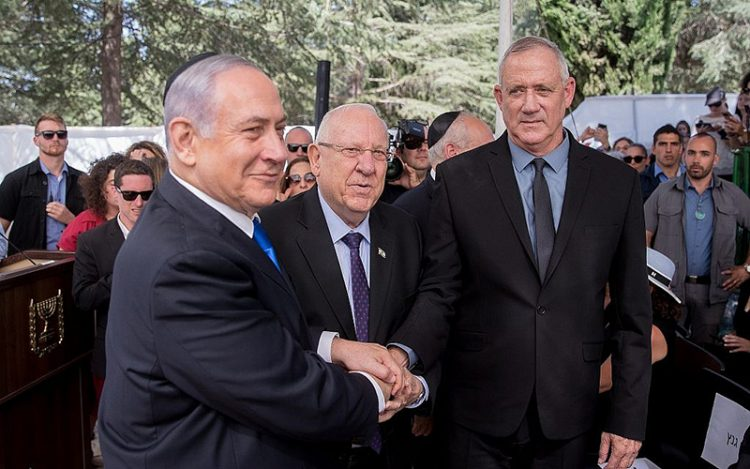 Israel's President Reuven Rivlin, center, meets with Israeli Prime Minister Benjamin Netanyahu, and Blue and White Party leader Benny Gantz.