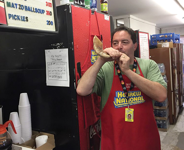 Marc Freedman sounds the shofar after every 'Oy Vey Sandwich' is prepared.  Photo by Steven A. Rosenberg/Journal Staff