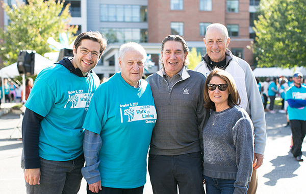 Adam Berman, president of CJL; Barry Berman, chief executive officer of CJL; 2019 Walk Ambassadors Alan and Phyllis Bolotin; and Matt Siegel, DJ at KISS 108.