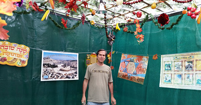Barbara Rosenstroch's husband, George Gammel, inside their Marblehead sukkah.