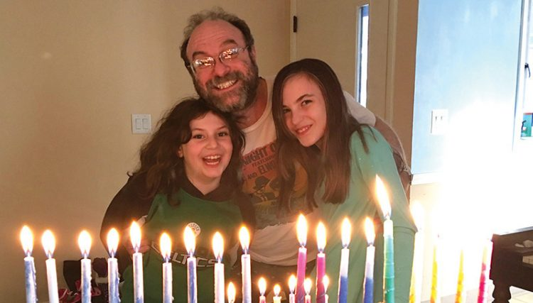 The Breitkopf-Valkenaar family of Beverly celebrates Hanukkah and Christmas.