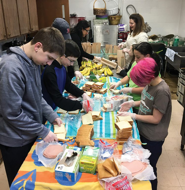 Volunteers at Temple Tiferet Shalom prepare meals for the homeless of Peabody.