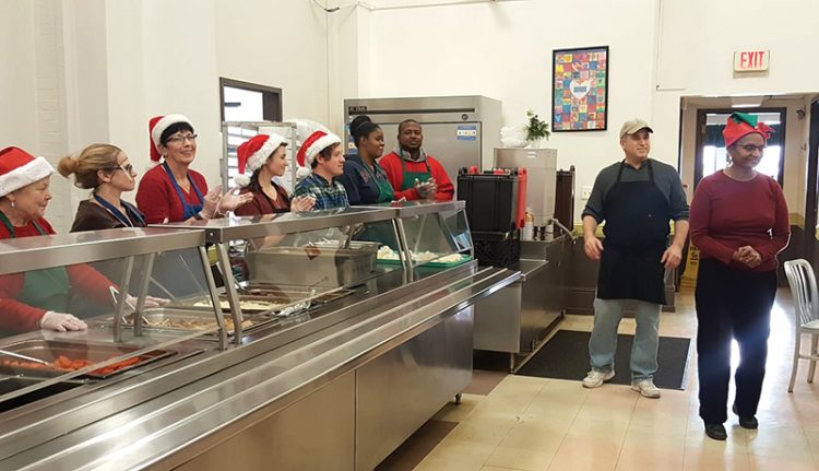 At My Brother's Table, volunteers prepare to serve meals to over 350 people on Christmas.
