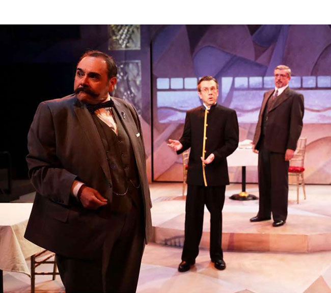 """Remo Airaldi, Scot Colford, and Will McGarrahan in Lyric Stage Company of Boston production of """"Agatha Christie's Murder on the Orient Express."""" / Photo: Mark S. Howard"""