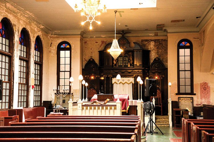 The second-floor sanctuary of the Vilna Shul, built a century ago, features a magnificent Torah ark. Full restoration of the original murals will be completed in the next phase of renovation. Courtesy Vilna Shul/Center for Jewish Culture