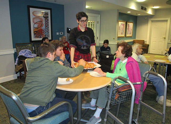 """Students and seniors celebrated an early Hanukkah on Dec. 8 as part of the """"Better Together"""" program at Kaplan Estates Assisted Living in Peabody."""