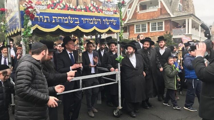 Members of the Monsey Jewish community march in solidarity following last Saturday's attack that wounded five Jews.