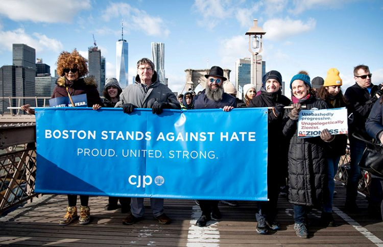 Rabbi Yossi Lipsker (third from left) and CJP President Marc Baker join 25,000 others protesting anti-Semitism in New York.