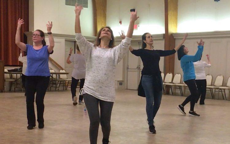 Larisa Brockman, Talya Paul, Marina Erijman, and Rachel Jacobson dance at Temple Sinai. Photo: Michael Wittner/Journal Staff