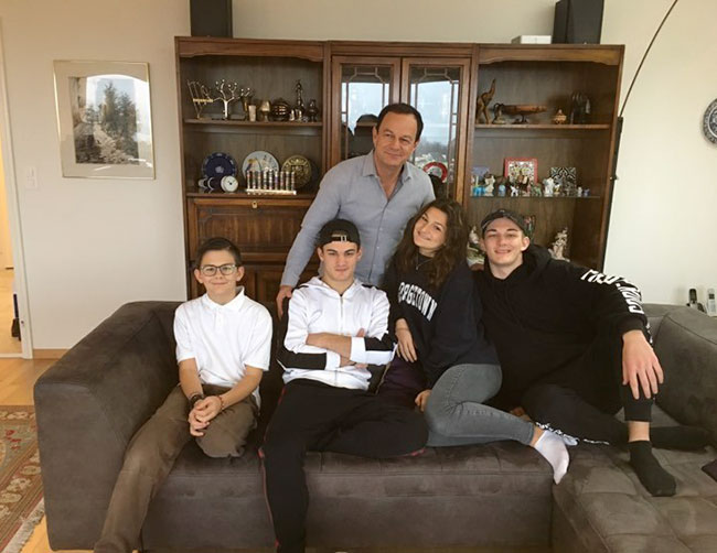 """""""The only way to stop this virus is to limit contagion,"""" writes Dr. Misha Pless (above with his children)."""