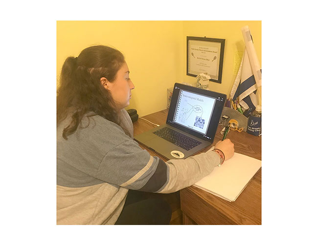 Elana Zabar, a junior at the University of New Hampshire, studying at home in Swampscott.