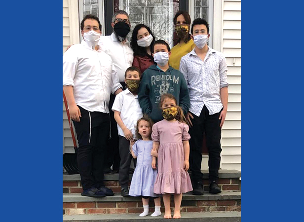 Rabbi Nechemia Schusterman (back row, second left), and his family, were in quarantine during Passover.