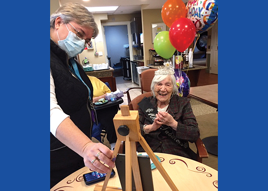 Sylvia Hertzel celebrates her 100th birthday party at Brudnick Center with Activities Assistant Judy Mullen.