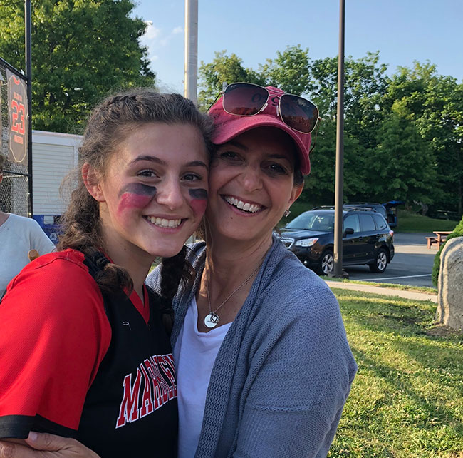 Emma Ferrante and her mom, Heidi Ferrante, after a softball game last season.